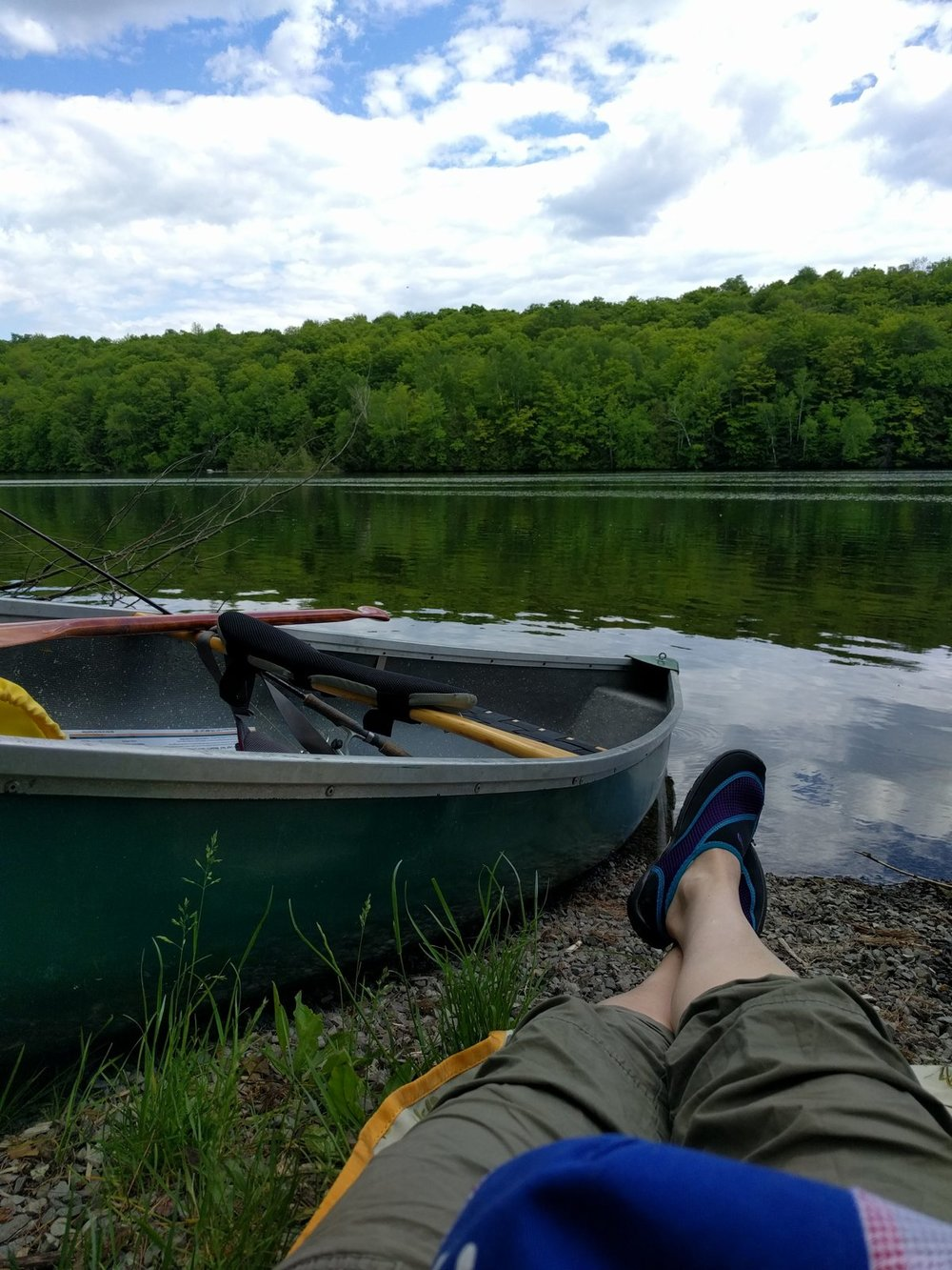 Jen Rossmann - Relaxing on the shores of the Madawaska River after a morning paddle.