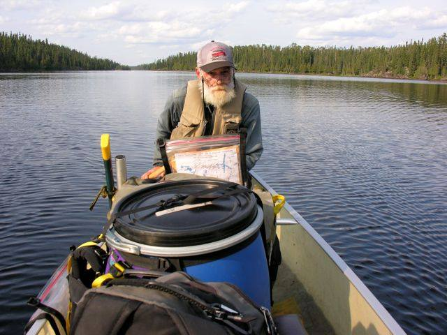 Phil keeping us on the straight and narrow, all the way down 14km long Slim River to Slim Lake. -Photo from the Friends of Wabakimi