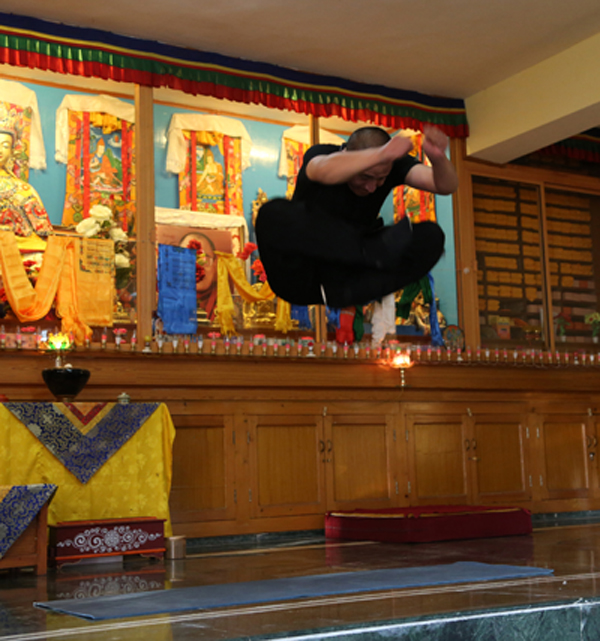 Tulku Lobsang doing the full Vajra Jump in a monastery in India.