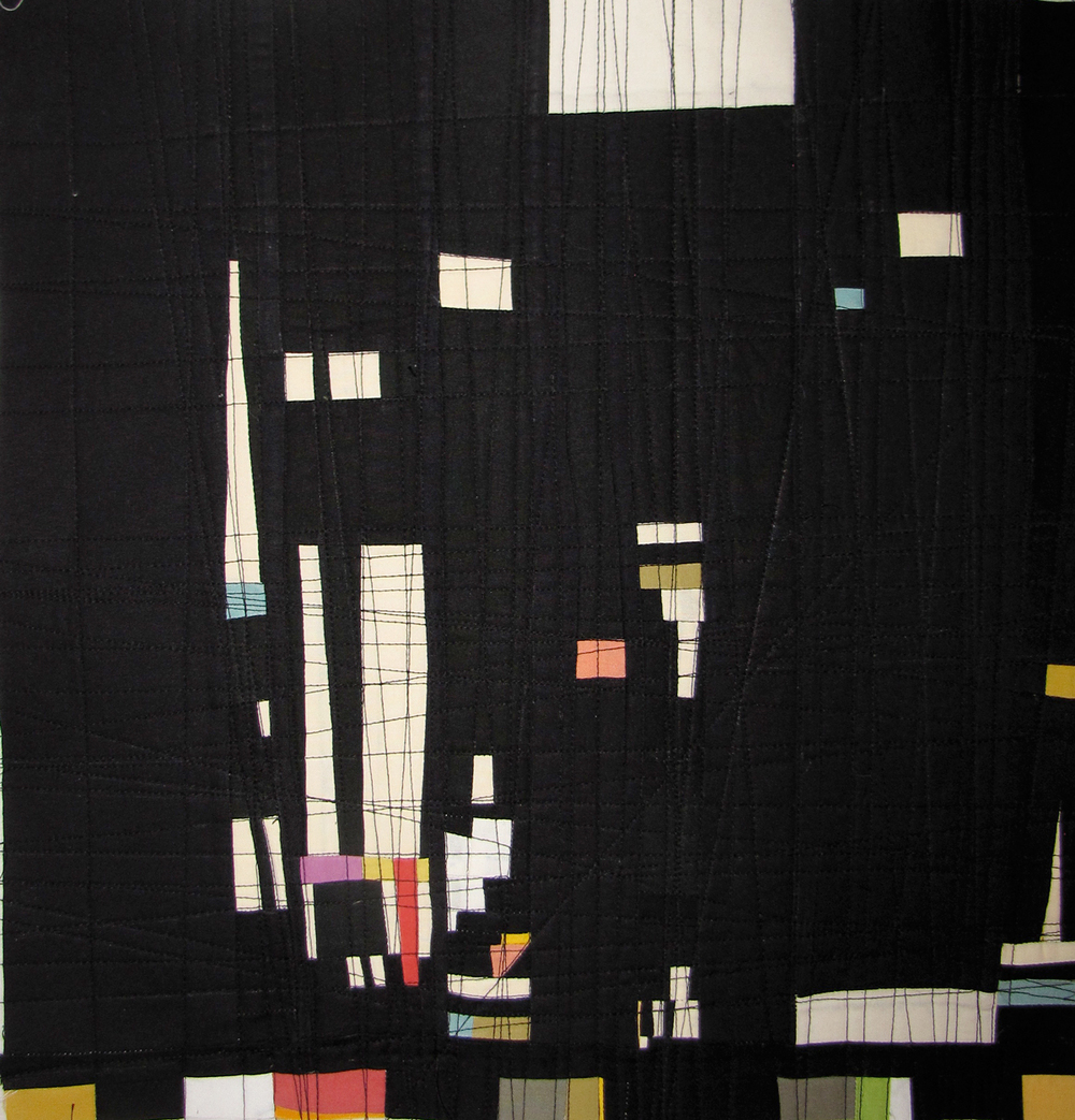 A before photo of the environment created for the drawings. The pieced fabric is composed of random scraps of solid colored fabrics. The striations of black stitching across the piece are based on stitching a straight line at every intersection of two fabrics. This black on black texture is hard to see in this shot. The piece is about 17 inches square.