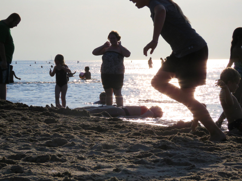 Lake Michigan beaches are crowded with families this weekend.