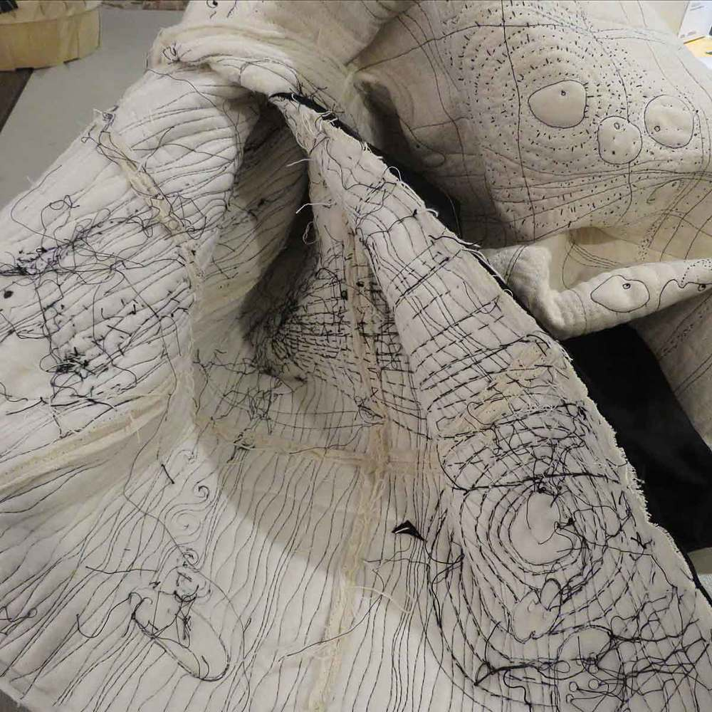 """""""Pillowcasing"""" the quilt by adding a fabric backing and turning the piece right side out protects the stitching while also hiding the chaos of the stitch."""
