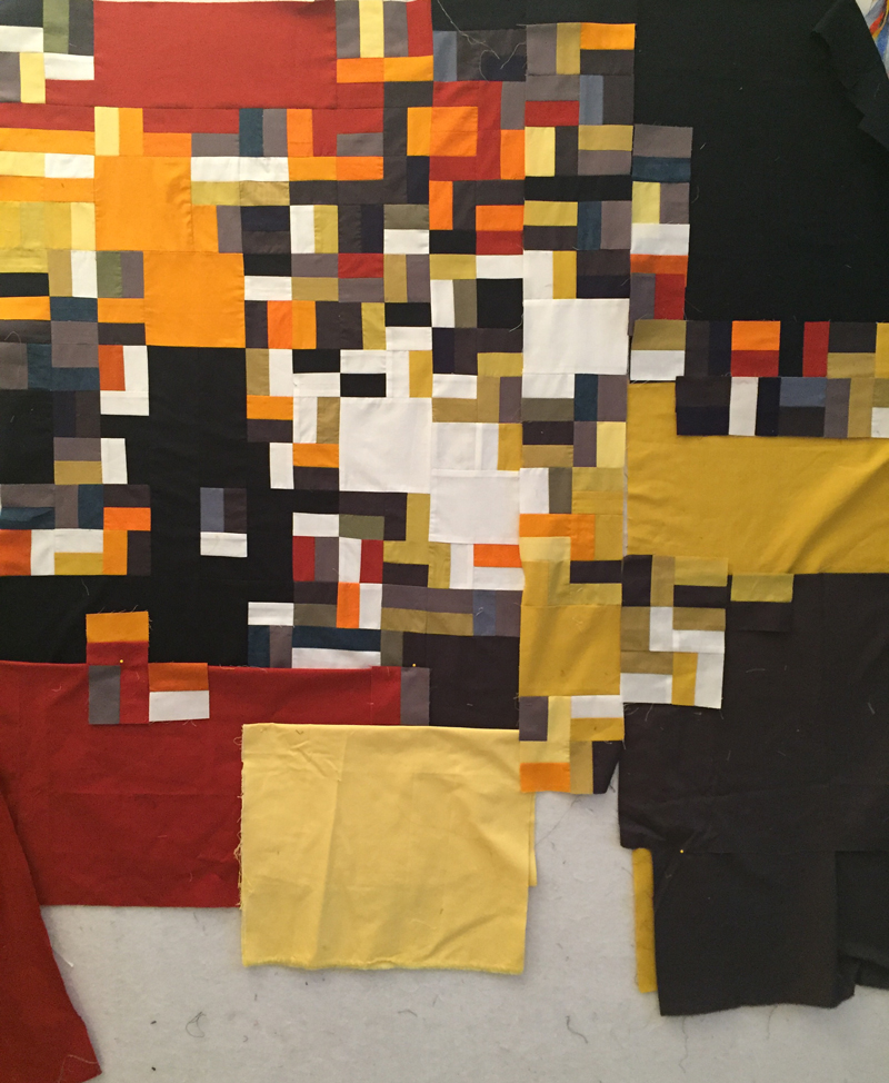 Assembling a group of extras gives me a playground for stitch. This is a work-in-progress that started with two-inch strips sewn together and then cut into rectangles.