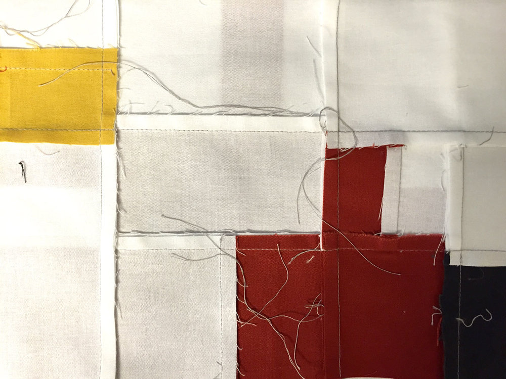 Stitching scraps together brings new meaning to the whole.