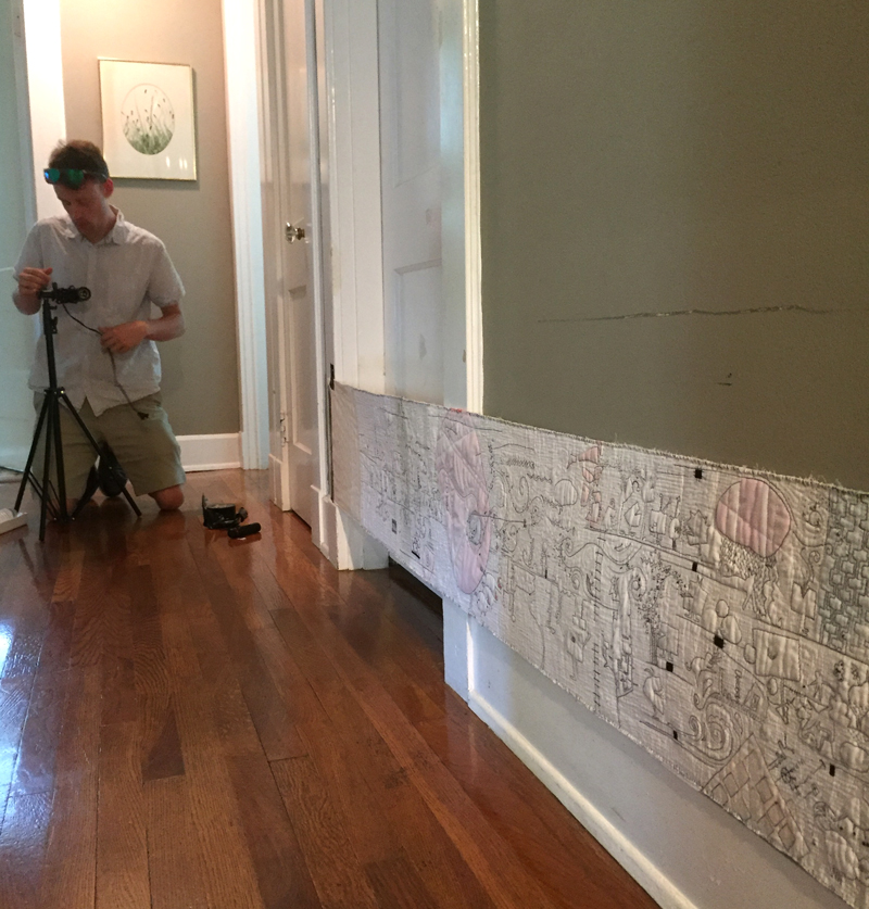 With the scroll finished I enlisted my son to do a video of it. We taped it to the hallway wall, mounted a camera to a skateboard and recorded a non-stop video. It gave me an idea of what the scroll would look like in motion.