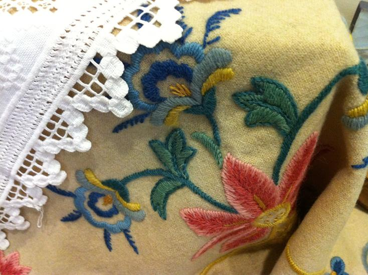 An embroidered tablecloth, patterned in the style of  a bunad, a Norwegian regional folk costume.... Beautiful!