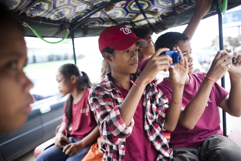 the cutest kiddos shooting in the tuk tuk while teaching photo to students from anjali house in siem reap, cambodia.