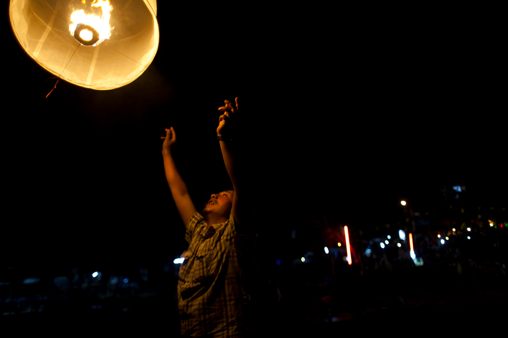 Lucky releases his one millionth lantern on New Year's Eve, 2013 on Rayong Beach, Thailand.