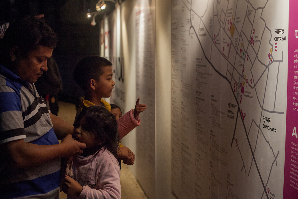 kids_family_interacting_with_big_map