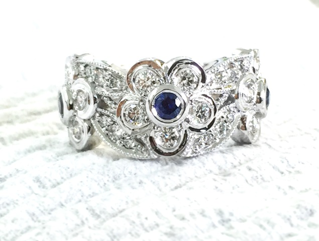 Sapphire and diamond flower ring.jpg