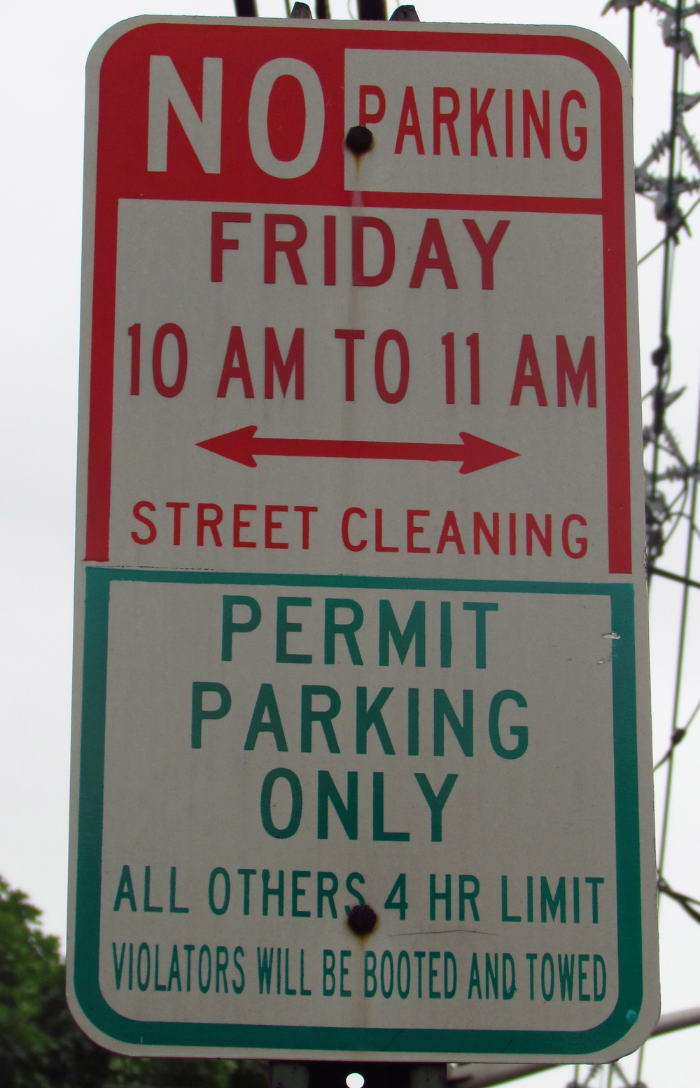"Non-Residents     Non-residents must park on sides marked with green and white signs designating ""4-hour Non-Resident Parking."""