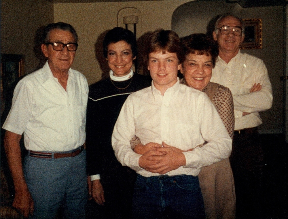 My mom on the left, between me and her father, Grandpa Bob. Grandma Flo has me in her hold and my father John is in the back.
