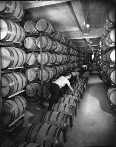Bourbon goes wtih Kentucky like basketball and betting on horseraces. These barrels were photographed in Louisville, where Maker's Mark corporate offices are, in 1935, about 20 years before Bill Samuels Sr. developed his recipe for a smoother tasting bourbon that used red winter wheat instead of rye, and would be aged about six or seven years, depending on the year. Source: University of Louisville photographic archives.