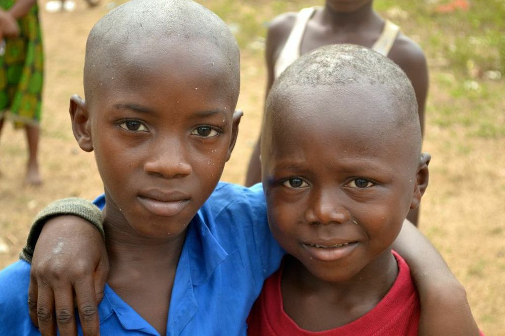 Two boys in a remote village in Sierra Leone, where food and clean water -- but not smiles -- are hard to come by. (Photo by Michael A. Lindenberger)