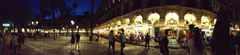 Evening in Barcelona's Placa Reial, home to nightclubs, restaurants acrobats and idlers of all description.  Captions for photos just below are at end of page.