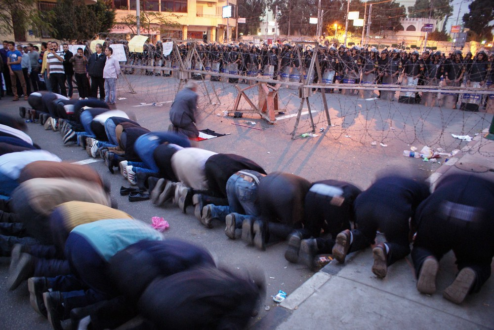 A prayer in front of the line of Central Security Forces punctuated the chants.