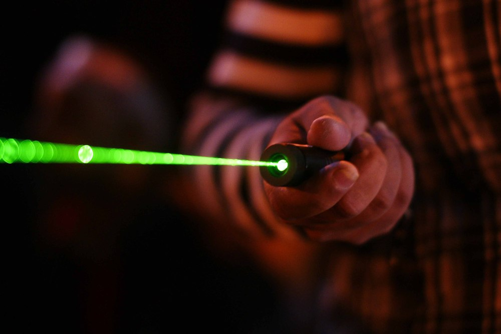 These laser pointers have become a common sight at the protests. They're used by some of the Ultras to shine on news cameras (blocking them), or to sight tear gas canisters in the night sky as they fall, in order to avoid injuries.
