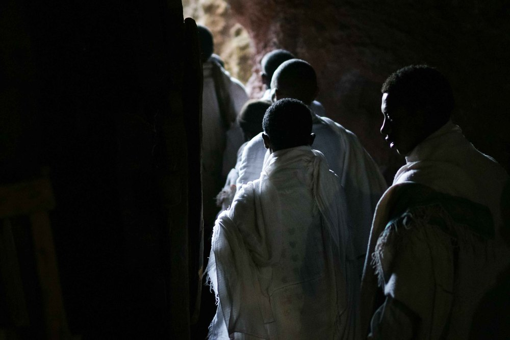 Narrow tunnels underneath the churches and within the mountain connect the churches, and as the number of pilgrims swell dramatically with Christmas approaching, the passages become an increasingly tight traverse. Stories of long treks echo off the cool stone, with one pilgrim telling me of his group's barefoot journey of more than 8 days in order to reach Lalibela. As so many villages are within reach, more than 60,000 pilgrims descend on the churches each Christmas.