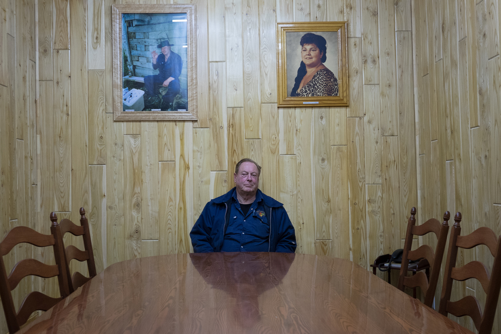 Étienne St. Pierre, sitting in his office in Kedgwick, New Brunswick, argues that because he has a federal permit, he should be able to buy and sell to whomever he chooses. Leyland Cecco/ Al Jazeera America
