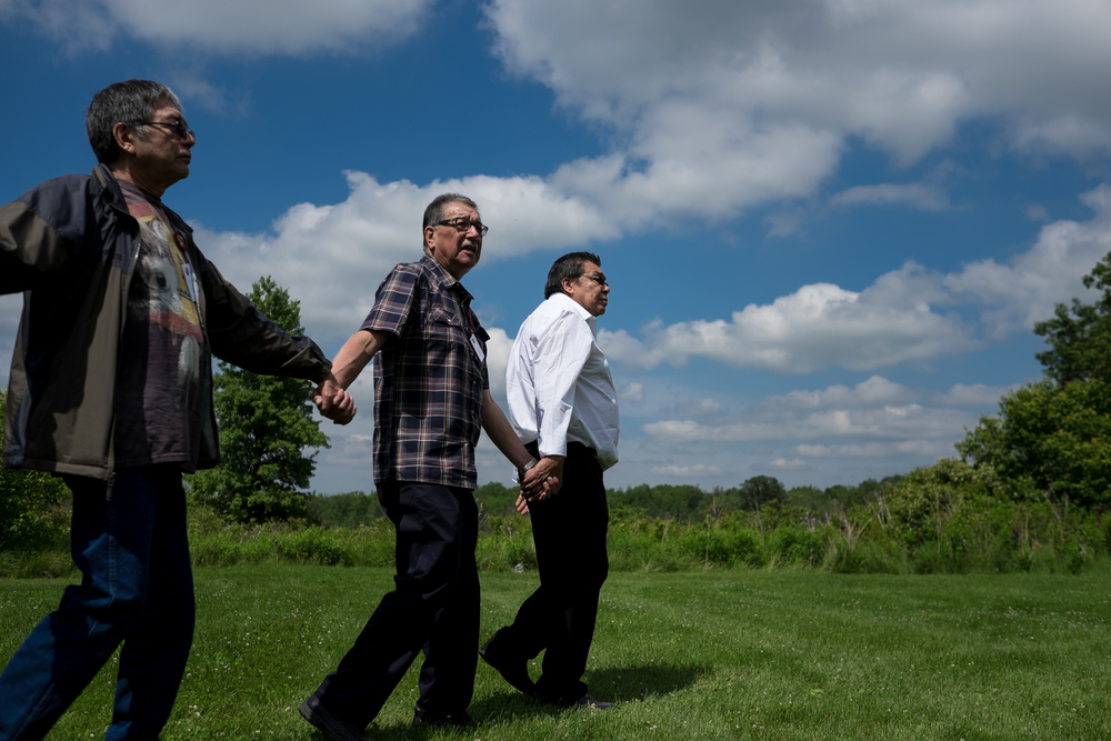 Bill Merasty (Left), Bill Chippeway and Charlie Bittern participate in a friendship dance on the lands of the New Credit.