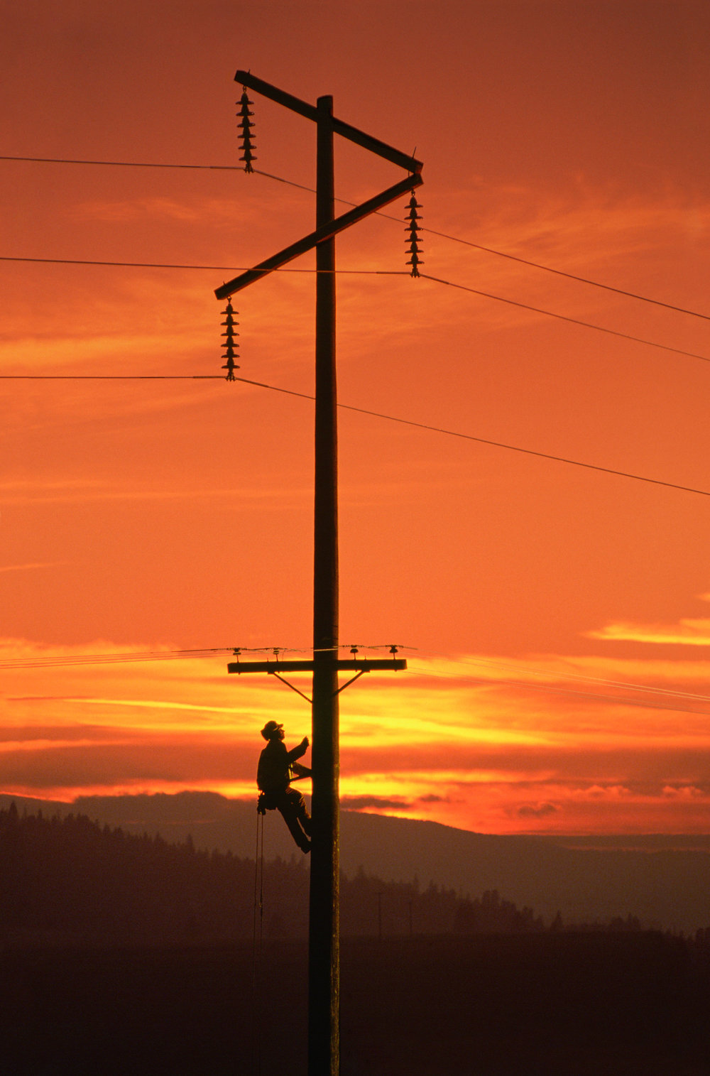 lineman working sunset