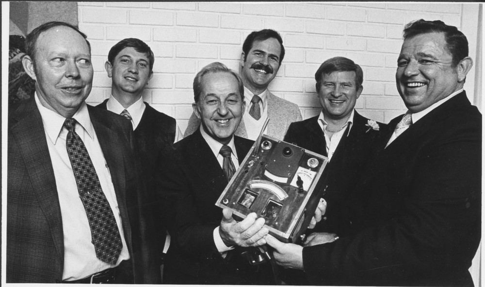 Borkenstein (third from left) stands with colleagues displaying his Breathalyzer Prototype, circa 1954.