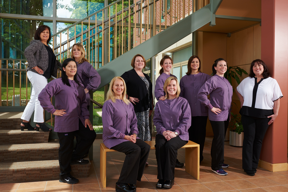 Professional photograph of a dentist office staff in an office building environment