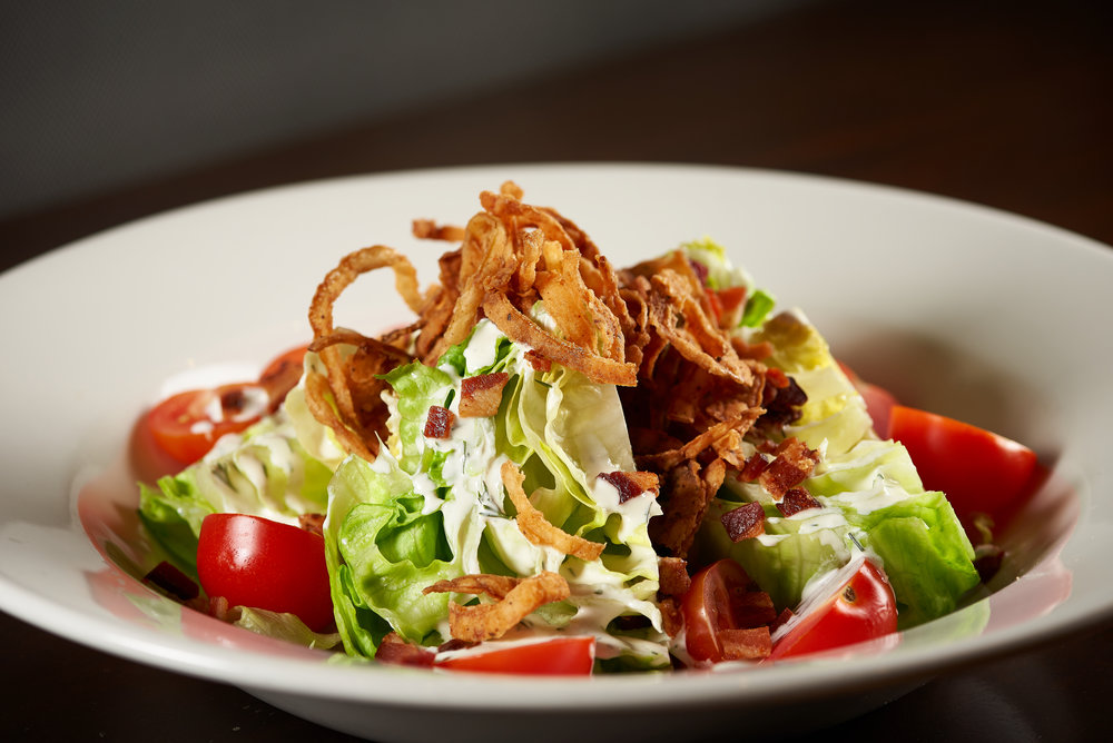 Professional food photo of a wedge salad with tomatoes. Commercial photography