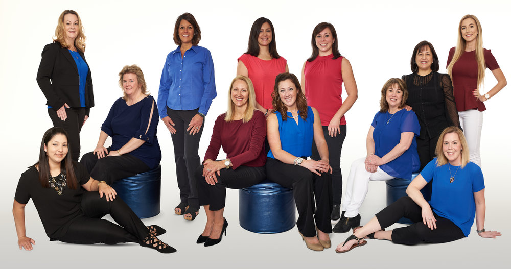 Professional photograph of a dentist office staff in studio environment with a solid white background