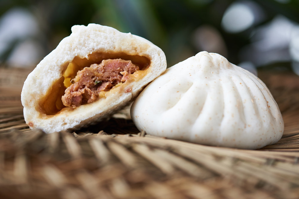 Professional food photo of a juicy pork bao bao. Commercial photography