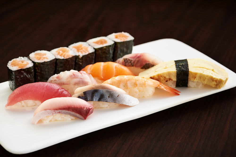 Professional food photo of assorted sushi. Tuna, salmon, shimp. Commercial photography