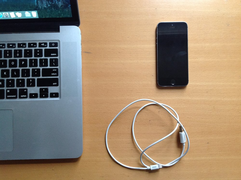 Mac, iPhone 5s and USB to Lightning cable.