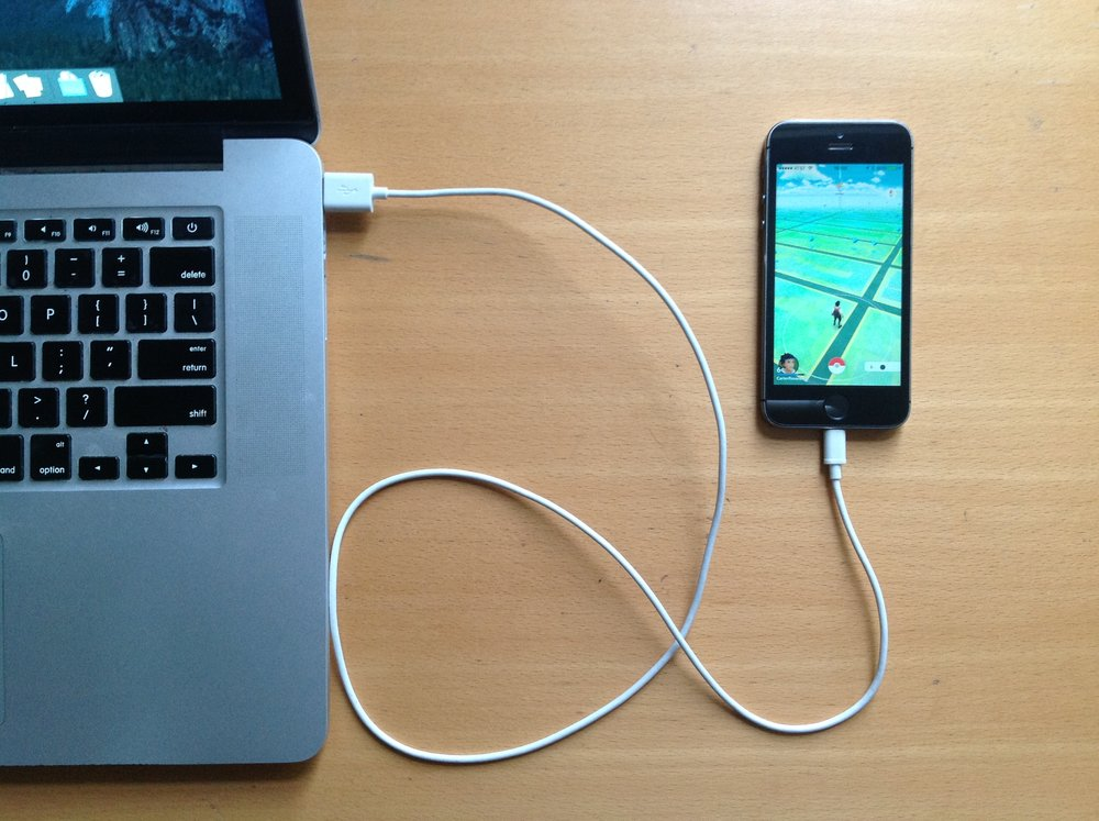 iPhone 5s connected to Mac by USB to Lightning cable.