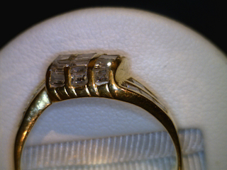 Before  Channel repair, Note there is no metal above the diamonds leaving them at risk to fall out or be damaged