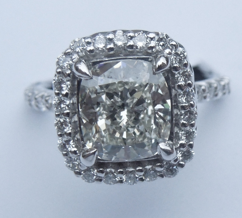 top-view-unique-cushion-cut-diamond-halo-delicate-engagement-ring-grand-rapids-jewelry-store-craft-revival