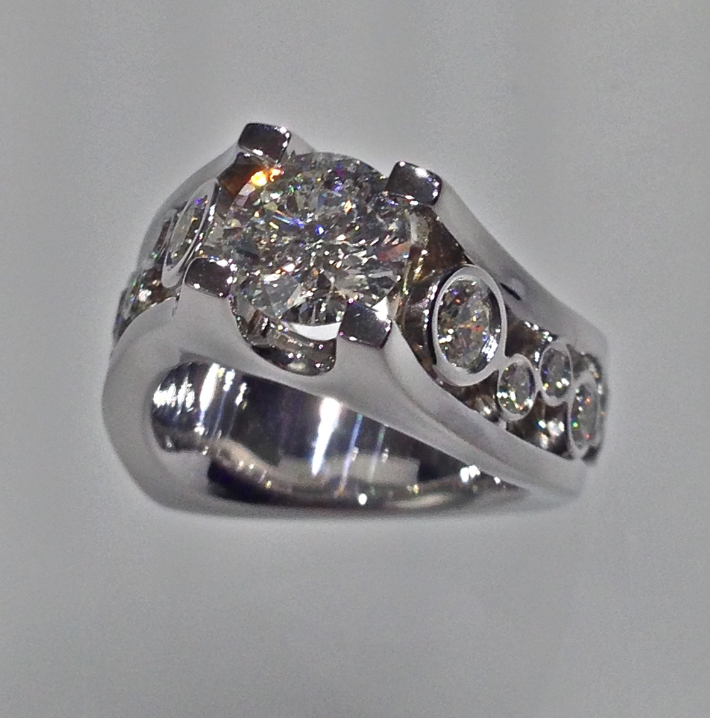 top-view-unique-round-cut-diamond-twist-engagement-ring-modern-craft-revival-jewelry-store-grand-rapids