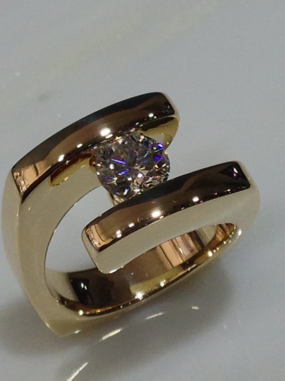 unique-modern-yellow-gold-round-diamond-engagement-ring-craft-revival-jewelry-store-grand-rapids