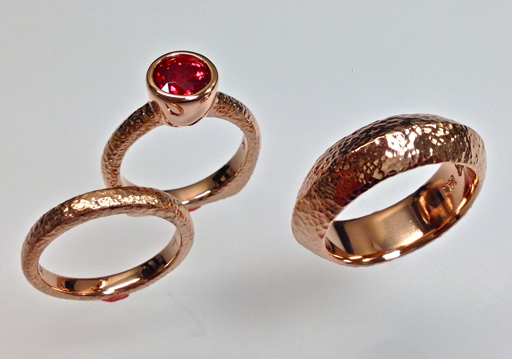 unique-wedding-set-gents-hammered-band-ladies-matching-hammered-band-ruby-bezel-minimal-engagement-ring-craft-revival-jewelry-store-grand-rapids