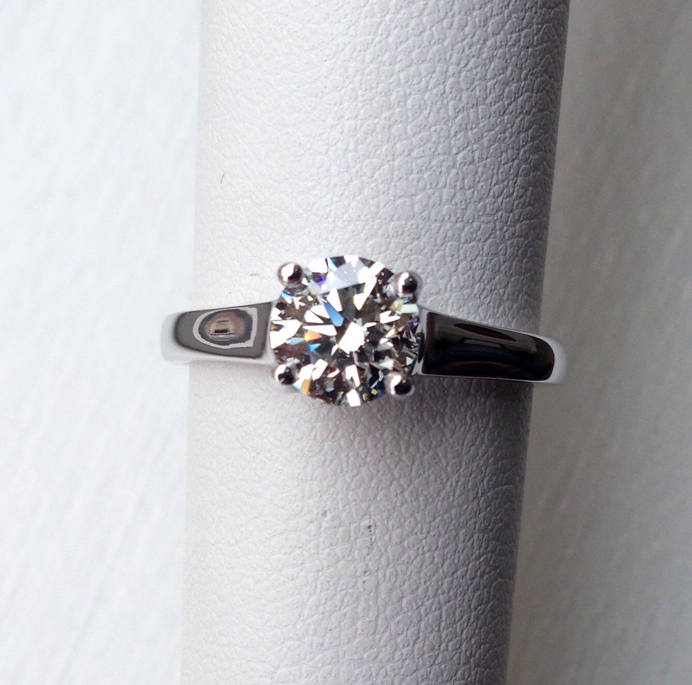 unique-delicate-round-diamond-white-gold-engagement-ring-craft-revival-jewelry-store-grand-rapids