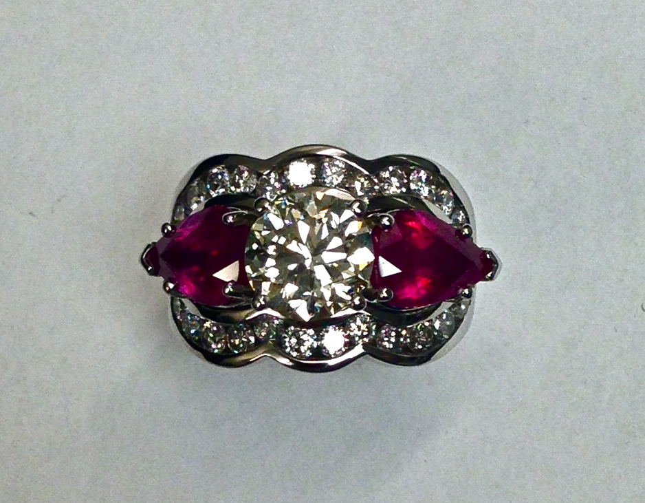 unique-three-stone-ring-round-diamond-pear-shape-ruby-halo-engagement-ring-craft-revival-jewelry-store-grand-rapids