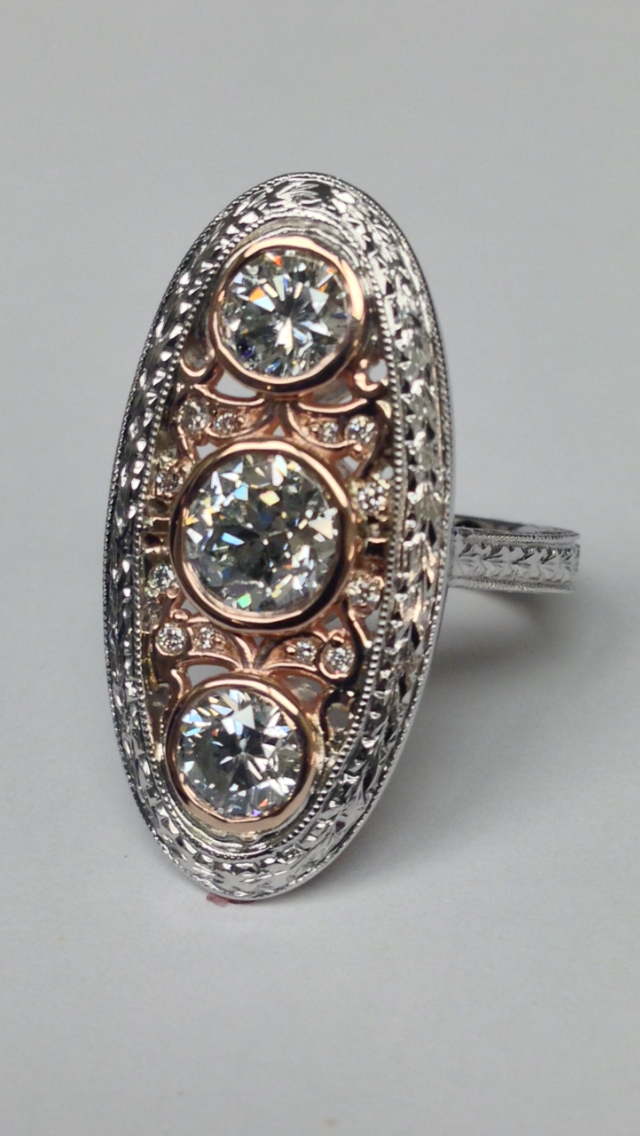 unique-three-stone-diamond-vintage-antique-engagement-ring-rose-gold-white-gold-craft-revival-jewelry-store-grand-rapids