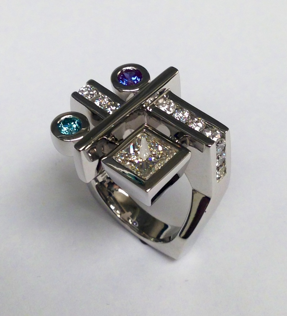 unique-modern-tanzanite-blue-diamond-princess-cut-diamond-engagement-ring-craft-revival-jewelry-store-grand-rapids