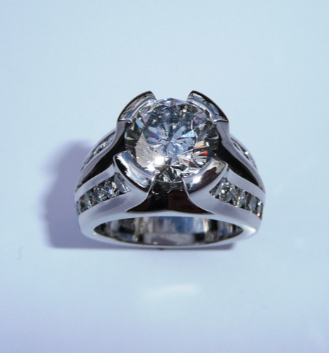 unique-round-diamond-semi-bezel-modern-design-diamond-accent-engagement-ring-white-gold-craft-revival-jewelry-store-grand-rapids