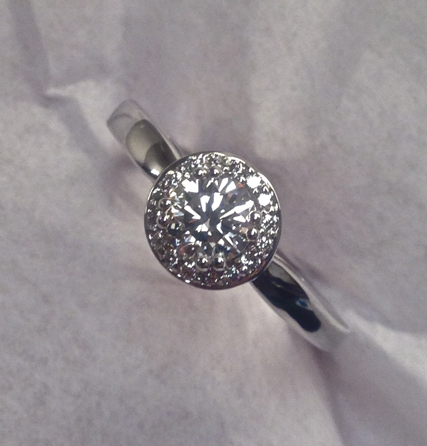 unique-minimal-delicate-diamond-halo-round-diamond-white-gold-craft-revival-jewelry-store-grand-rapids