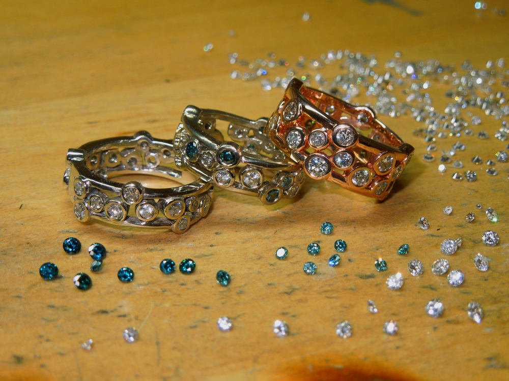unique-custom-modern-wedding-rings-wedding-bands-colored-diamonds-blue-stone-band-craft-revival-jewelry-store-grand-rapids
