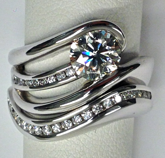 unique-modern-twist-white-gold-wedding-set-wedding-band-diamond-craft-revival-jewelry-store-grand-rapids