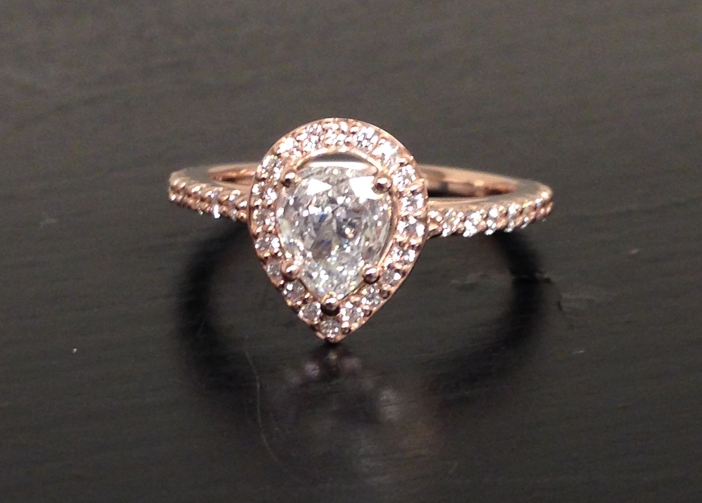 unique-pear-shape-diamond-delicate-halo-rose-gold-engagement-ring-craft-revival-jewelry-store-grand-rapids