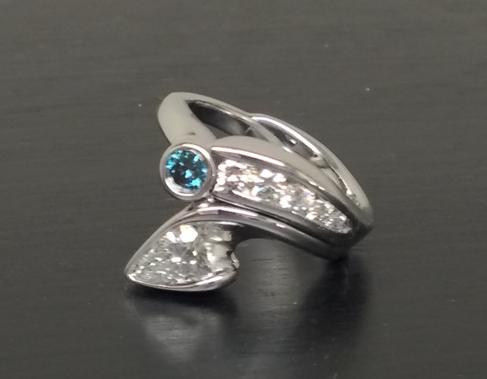 side-view-unique-diamond-engagement-ring-modern-design-blue-diamond-pear-shape-diamond-craft-revival-jewelry-store-grand-rapids