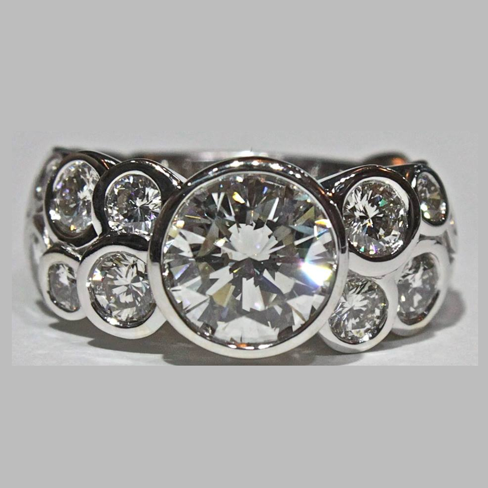 unique-modern-round-diamond-bezel-set-engagement-ring-craft-revival-jewelry-store-grand-rapids