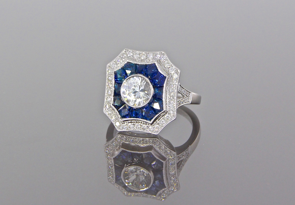 unique-white-sapphire-custom-cut-blue-sapphire-diamond-double-halo-vintage-engagement-ring-craft-revival-jewelry-store-grand-rapids